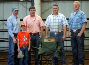 Hog Division winners from left to right are Judge Joe Osbourn; 1st Jacob McKillip, Lafayette, IN; 2nd Cody Richison, Bristo, OK; 3rd Clay Carlson, Stoneham, CO.