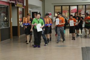 Members from the Cowboy Baseball stroll through Arrowhead Mall in the fight against Domestic Violence. More than 75 participated in all for Connors State College.