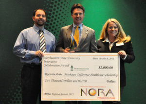 The Muskogee Difference Health Scholarship, a scholarship promoting health education, was recently awarded the Innovative Collaboration Award by the Northeast Oklahoma Regional Alliance.  Accepting the award are (L to R): Dr. Tracy Hoos, pediatrician representing the City of Muskogee Foundation, Dr. Tim Faltyn, President of Connors State College, and Lisa Wade, MDHS Director.
