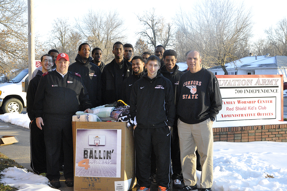 The Connors State College men's basketball team, pictured here with Lt. Jason Sebo of The Salvation Army, donated more than 60 blankets to the Muskogee Salvation Army.  Faculty, staff and students at all three Connors campuses participated in a wide variety of community service projects this holiday season.