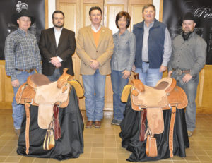 Bobby and Vicki Mouser recently donated two saddles to the Connors State College Equine and Rodeo programs.  These saddles will be auctioned at the Alumni & Friends Equine & Rodeo Spring Gathering to raise funds for the programs.  Pictured are (L to R):  Jake Walker, CSC Assistant Rodeo Coach; Ryan Blanton, Executive Director of the Connors Development Foundation; Dr. Tim Faltyn, President of Connors State College; Vicki Mouser, Bob Mouser, Jake Lawson, CSC Equine Director and Head Rodeo Coach.