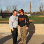 Perry Keith talks with CSC president Dr. Tim Faltyn after returning from his 1400th win