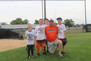 The Connors State College Athletics Department recently completed their All Skills Baseball Camp.  The camp was open to youth 5-14 years of age and taught them the basic skills needed for the sport of baseball.  Coach Perry Keith poses with camp members.