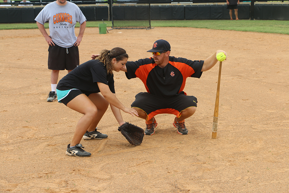 Connors State College Assistant Softball Coach, Michael Deese, teaches a student the basics of the game at the CSC Softball Camp held Sat., June 28.  To learn about other youth summer camps available at Connors State College visit www.connorsstate.edu.