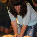 Babysitter Boot Camp participant Molley Paden, 13, of Keys, learns the proper techniques to administer CPR on small children and infants.