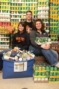 Brandi Center, Nella Worthan and Blake Miller help with the PTK Food Drive